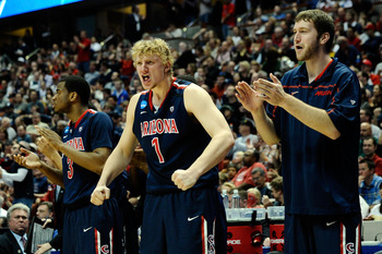 ANAHEIM, CA - MARCH 26:  Kevin Parrom #3 and Kyryl Natyazhko #1 of the Arizona Wildcats reacts from the bench against the Connecticut Huskies during the west regional final of the 2011 NCAA men's basketball tournament at the Honda Center on March 26, 2011