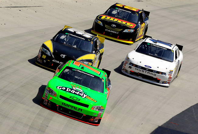 BRISTOL, TN - MARCH 19:  Danica Patrick, driver of the #7 GoDaddy.com Chevrolet, leads a group of cars during the NASCAR Nationwide Series Scotts EZ Seed 300 at Bristol Motor Speedway on March 19, 2011 in Bristol, Tennessee.  (Photo by Chris Trotman/Getty