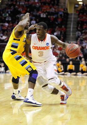 CLEVELAND, OH - MARCH 20:  Dion Waiters #3 of the Syracuse Orange handles the ball against the Marquette Golden Eagles during the third of the 2011 NCAA men's basketball tournament at Quicken Loans Arena on March 20, 2011 in Cleveland, Ohio.  (Photo by Gr