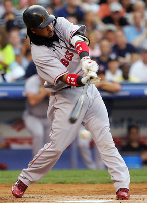 NEW YORK - JULY 03:  Manny Ramirez #24 of the Boston Red Sox hits into a run scoring fielders choice in the first inning against the New York Yankees on July 3, 2008 at Yankee Stadium in the Bronx borough of New York City.  (Photo by Jim McIsaac/Getty Ima