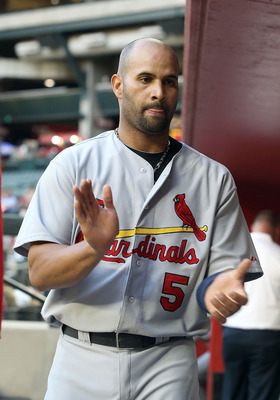 PHOENIX, AZ - APRIL 12:  Albert Pujols #5 of the St. Louis Cardinals in the dugout during the Major League Baseball game against the Arizona Diamondbacks at Chase Field on April 12, 2011 in Phoenix, Arizona. The Diamondbacks defeated the Cardinals 13-8.