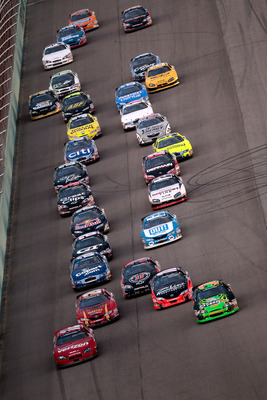 Danica Patrick leads the field for a restart at Homestead last season.