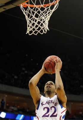 TULSA, OK - MARCH 18:  Marcus Morris #22 of the Kansas Jayhawks goes up for a shot against the Boston University Terriers during the second round of the 2011 NCAA men's basketball tournament at BOK Center on March 18, 2011 in Tulsa, Oklahoma.  (Photo by T