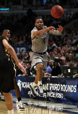 CHICAGO, IL - MARCH 18:  Chris Wright #4 of the Georgetown Hoyas passes against the Virginia Commonwealth Rams in the first half during the second round of the 2011 NCAA men's basketball tournament at the United Center on March 18, 2011 in Chicago, Illino
