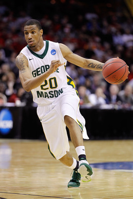 CLEVELAND, OH - MARCH 18: Cam Long #20 of the George Mason Patriots handles the ball against the Xavier Musketeers during the second round of the 2011 NCAA men's basketball tournament at Quicken Loans Arena on March 18, 2011 in Cleveland, Ohio.  (Photo by