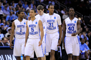 NEWARK, NJ - MARCH 25:  Dexter Strickland #1, Kendall Marshall #5, John Henson #31 and Harrison Barnes #40  of the North Carolina Tar Heels walk on the court after a play against the Marquette Golden Eagles during the east regional semifinal of the 2011 N