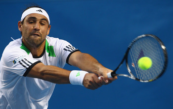 MELBOURNE, AUSTRALIA - JANUARY 22:  Marcos Baghdatis of Cyprus plays a backhand n his third round match against Jurgen Melzer of Austria during day six of the 2011 Australian Open at Melbourne Park on January 22, 2011 in Melbourne, Australia.  (Photo by Q