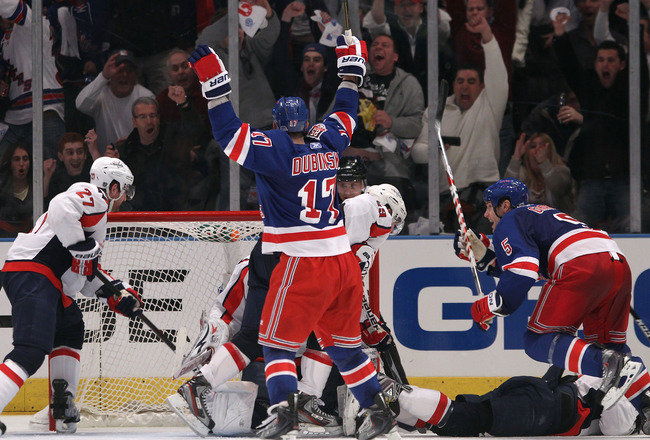 NEW YORK, NY - APRIL 17: Brandon Dubinsky #17 of the New York Rangers celebrates after he scored the game-winning goal late in the third period against the Washington Capitals in Game Three of the Eastern Conference Quarterfinals during the 2011 NHL Stanl