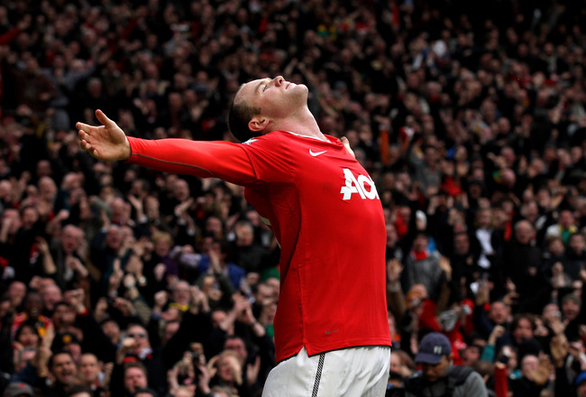 MANCHESTER, ENGLAND - FEBRUARY 12:  Wayne Rooney of Manchester United celebrates after he scores a goal from an overhead kick during the Barclays Premier League match between Manchester United and Manchester City at Old Trafford on February 12, 2011 in Ma