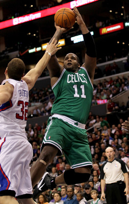 LOS ANGELES, CA - FEBRUARY 26:  Glen Davis #11 of the Boston Celtics shoots over Blake Griffin #32 of the Los Angeles Clippers at Staples Center on February 26, 2011  in Los Angeles, California.  The Celtics won 99-92.   NOTE TO USER: User expressly ackno