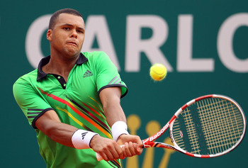 MONACO - APRIL 12:  Jo-Wilfried Tsonga of France plays a backhand in his match against Ivan Ljubicic of Croatia during Day Three of the ATP Masters Series Tennis at the Monte Carlo Country Club on April 12, 2011 in Monte Carlo, Monaco.  (Photo by Julian F