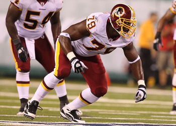 EAST RUTHERFORD, NJ - AUGUST 27:  Vonnie Holiday #79 of the Washington Redskins  in action against Vonnie Holiday during their preseason game on August 27, 2010 at the New Meadowlands Stadium  in East Rutherford, New Jersey.  (Photo by Al Bello/Getty Imag