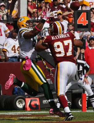 LANDOVER, MD - OCTOBER 10:  Lorenzo Alexander breaks up a pass on fourth and goal intended for Andrew Quarless #81 of the Green Bay Packers at FedExField on October 10, 2010 in Landover, Maryland.  (Photo by Win McNamee/Getty Images)
