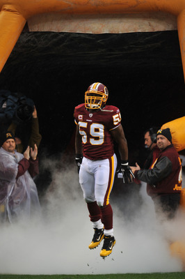 LANDOVER, MD - DECEMBER 12:  London Fletcher #59 of the Washington Redskins is introduced before the game against the Tampa Bay Buccaneers  at FedExField on December 12, 2010 in Landover, Maryland. The Buccaneers defeated the Redskins 17-16. (Photo by Lar