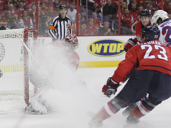 WASHINGTON, DC - APRIL 15:  Michal Neuvirth #30 of the Washington Capitals is covered in snow in the game against the Washington Capitals in Game Two of the Eastern Conference Quarterfinals during the 2011 NHL Stanley Cup Playoffs at Verizon Center on Apr