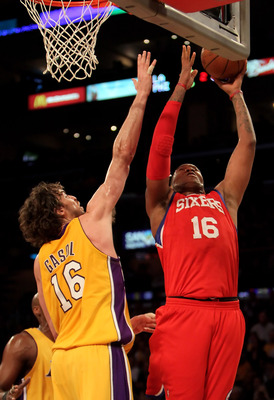 LOS ANGELES, CA - FEBRUARY 26:  Marreese Speights #16 of the Philadelphia 76ers drives to the basket while being defended by Pau Gasol #16 of the Los Angeles Lakers in the first half at Staples Center on February 26, 2010 in Los Angeles, California. The L