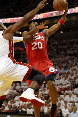 MIAMI, FL - APRIL 16: Guard Jodie Meeks #20 of the Philadelphia 76ers drives against Dwyane Wade #3 of the Miami Heat at the American Airlines Arena in Game One of the Eastern Conference Quarterfinals in the 2011 NBA Playoffs on April 16, 2011 in Miami, F