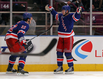 NEW YORK, NY - APRIL 17:  (L-R) Brian Boyle #22 and Erik Christensen #26 of the New York Rangers celebrate after Christensen scored a second period goal against the Washington Capitals in Game Three of the Eastern Conference Quarterfinals during the 2011