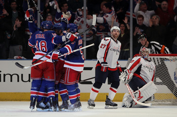 NEW YORK, NY - APRIL 17:  The New York Rangers celebrate after Vaclav Prospal #20 of the New York Rangers scored a second period goal in the third period against goalie Michal Neuvirth #30 and Karl Alzner #27 of the Washington Capitals in Game Three of th