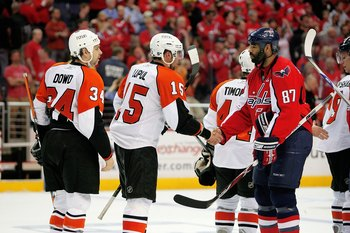 WASHINGTON - APRIL 22:  Donald Brashear #87 of the Washington Capitals shakes the hand of Joffrey Lupul #15 of the Philadelphia Flyers after a series clinching win during game seven of the Eastern Conference Quarterfinals of the 2008 NHL Stanley Cup Playo