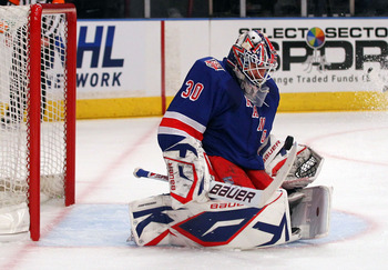 NEW YORK, NY - APRIL 17:  Goalie Henrik Lundqvist #30 of the New York Rangers makes a save against the Washington Capitals in the first period of Game Three of the Eastern Conference Quarterfinals during the 2011 NHL Stanley Cup Playoffs at Madison Square
