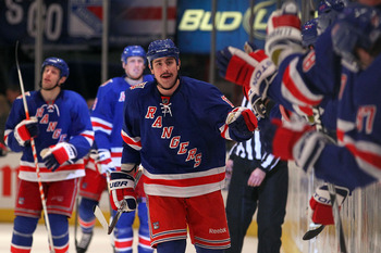 NEW YORK, NY - APRIL 17:  Brandon Dubinsky #17 of the New York Rangers celebrates with teammates on the bench after he scored the game winning goal against the Washington Capitals in Game Three of the Eastern Conference Quarterfinals during the 2011 NHL S