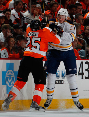 PHILADELPHIA, PA - APRIL 16:  Tyler Myers #57 of the Buffalo Sabres is checked by Matt Carle #25 of the Philadelphia Flyers during the first period of Game Two of the Eastern Conference Quarterfinals during the 2011 NHL Stanley Cup Playoffs at Wells Fargo