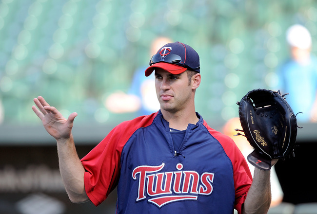 BALTIMORE - JULY 22:  Joe Mauer #7 of the Minnesota Twins warms up before the game against the Baltimore Orioles at Camden Yards on July 22, 2010 in Baltimore, Maryland.  (Photo by Greg Fiume/Getty Images)