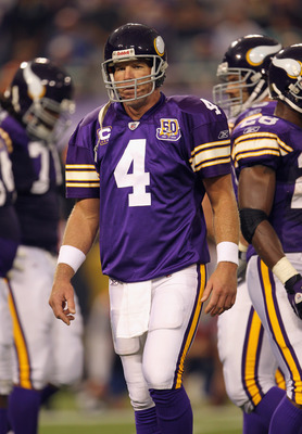 MINNEAPOLIS - SEPTEMBER 19:  Quarterback Brett Favre #4 of the Minnesota Vikings walks off the field after failing to make a first down during the first half of the game against the Miami Dolphins on September 19, 2010 at Hubert H. Humphrey Metrodome in M