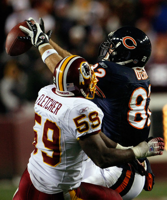 LANDOVER, MD - DECEMBER 06:  Tight end Greg Olsen #82 of the Chicago Bears makes a catch against linebacker London Fletcher #59 of the Washington Redskins in third quarter action at FedEx Field December 6, 2007 in Landover, Maryland. The Redskins won the