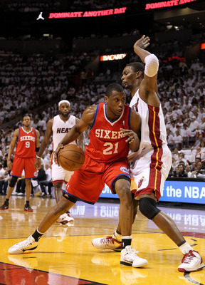 MIAMI, FL - APRIL 18:  Thaddeus Young #21  of the Philadelphia 76ers posts up Chris Bosh #1 of the Miami Heat  during game two of the Eastern Conference Quarterfinals  at American Airlines Arena on April 18, 2011 in Miami, Florida. NOTE TO USER: User expr