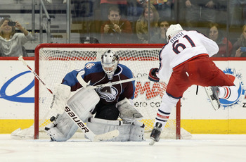 DENVER, CO - MARCH 22:  Goalie Brian Elliott #30 of the Colorado Avalanche makes a save on a shot by Rick Nash #61 of the Columbus Blue Jackets during their overtime shootout at the Pepsi Center on March 22, 2011 in Denver, Colorado. The Avalanche defeate