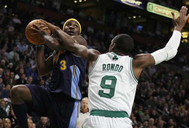 BOSTON, MA - DECEMBER 08:  Ty Lawson #3 of the Denver Nuggets heads for the basket as Rajon Rondo #9 of the Boston Celtics defends on December 8, 2010 at the TD Garden in Boston, Massachusetts. The Celtics defeated the Nuggets 105-89. NOTE TO USER: User e