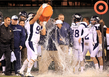 SAN FRANCISCO, CA - JANUARY 09:  Head coach Chris Ault of the Nevada Wolf Pack is covered in water by Mike Andrews #92  in the closing minute of their victory over Boston College in the Kraft Fight Hunger Bowl at AT&T Park on January 9, 2011 in San Franci