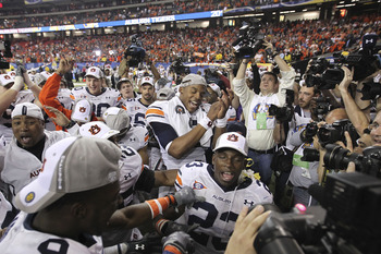 ATLANTA - DECEMBER 4:  Quarterback Cam Newton #2 of the Auburn Tigers (center) celebrates with his teammates after the 2010 SEC Championship game against South Carolina Gamecocks at Georgia Dome on December 4, 2010 in Atlanta, Georgia. (Photo by Mike Zarr