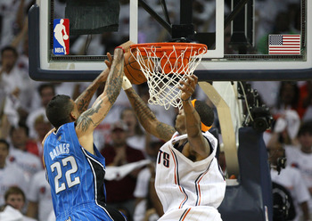 CHARLOTTE, NC - APRIL 24:  Forward Tyrus Thomas #12 of the Charlotte Bobcats blocks a shot by forward Matt Barnes #22 of the Orlando Magic during Game Three of the Eastern Conference Quarterfinals during the 2010 NBA Playoffs at Time Warner Cable Arena on