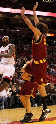 MIAMI, FL - DECEMBER 15:  LeBron James #6 of the Miami Heat passes around Anderson Varejao #17 of the Cleveland Cavaliers during a game  at American Airlines Arena on December 15, 2010 in Miami, Florida. NOTE TO USER: User expressly acknowledges and agree