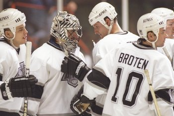 7 Jan 1997: Goaltender Stephane Fiset of the Los Angeles Kings is surrounded by team-mates; defenseman Jan Vopat, leftwinger Barry Potomski and center Neal Broten #10 after a game with the Vancouver Canucks at the Great Western Forum in Inglewood, Califor