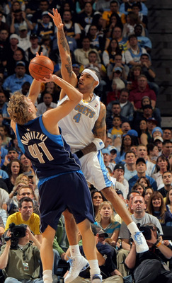 DENVER - MAY 03:  Kenyon Martin #4 of the Denver Nuggets goes up to block a shot by Dirk Nowitzki #41 of the Dallas Mavericks in Game One of the Western Conference Semifinals during the 2009 NBA Playoffs at Pepsi Center on May 3, 2009 in Denver, Colorado.