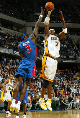 INDIANAPOLIS - DECEMBER 19:  Jermaine O'Neal #7 of the Indiana Pacers shoots the ball while defended by Ben Wallace #3 of the Detroit Pistons on December19, 2003 at Conseco Fieldhouse in Indianapolis, Indiana. NOTE TO USER: User expressly acknowledges and