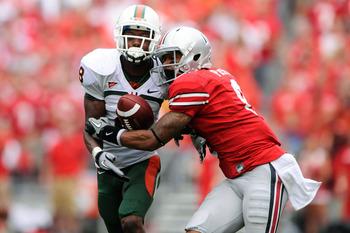 COLUMBUS, OH - SEPTEMBER 11:  DeVier Posey #8 of the Ohio State Buckeyes battles with DeMarcus Van Dyke #8 for possession of a pass at Ohio Stadium on September 11, 2010 in Columbus, Ohio.  The pass was incomplete.  (Photo by Jamie Sabau/Getty Images)