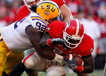ATHENS, GA - OCTOBER 03: Drake Nevis #92 of the Louisiana State University Tigers tackles Washaun Ealey #24 of the Georgia Bulldogs at Sanford Stadium on October 3, 2009 in Athens, Georgia. (Photo by Kevin C. Cox/Getty Images)