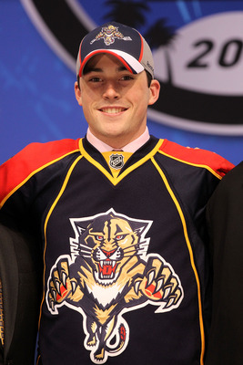 LOS ANGELES, CA - JUNE 25:  Erik Gudbranson, drafted third overall by the Florida Panthers poses on stage during the 2010 NHL Entry Draft at Staples Center on June 25, 2010 in Los Angeles, California.  (Photo by Bruce Bennett/Getty Images)