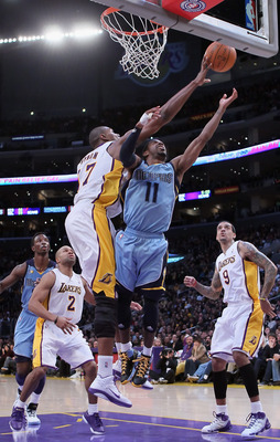 LOS ANGELES, CA - JANUARY 02:  Andrew Bynum #17 of the Los Angeles Lakers blocks a shot from Mike Conley #11 of the Memphis Grizzlies during the first half at Staples Center on January 2, 2011 in Los Angeles, California. NOTE TO USER: User expressly ackno