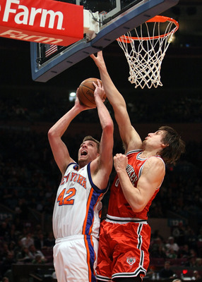 NEW YORK - DECEMBER 19: Andrew Bogut #6 of the Milwaukee Bucks blocks the shot of David Lee #42 of the New York Knicks on December 19, 2008 at Madison Square Garden in New York City, New York. NOTE TO USER: User expressly acknowledges and agrees that, by