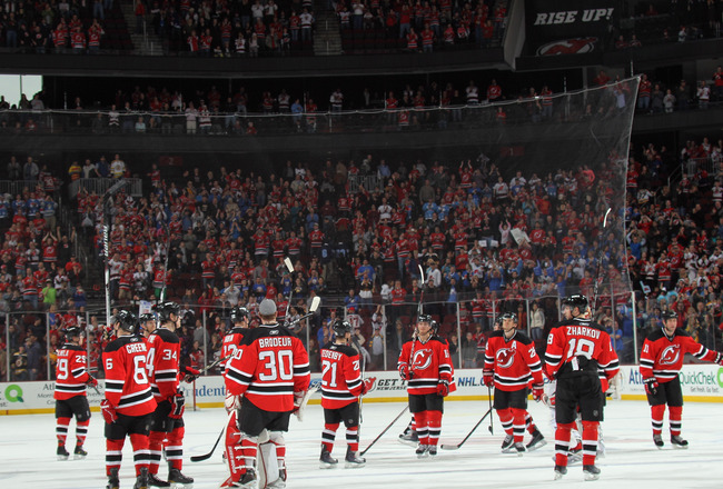 NEWARK, NJ - APRIL 10: The New Jersey Devils salute their fans following their last game of the season against the Boston Bruins at the Prudential Center on April 10, 2011 in Newark, New Jersey.  (Photo by Bruce Bennett/Getty Images)