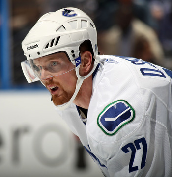 ATLANTA, GA - MARCH 25:  Daniel Sedin #22 of the Vancouver Canucks skates against the Atlanta Thrashers at the Philips Arena on March 25, 2011 in Atlanta, Georgia.  (Photo by Bruce Bennett/Getty Images)