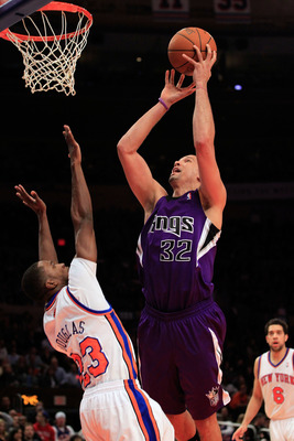 NEW YORK, NY - JANUARY 14:  Francisco Garcia #32 of the Sacramento Kings shoots the ball over the block of Toney Douglas #23 of the New York Knicks at Madison Square Garden on January 14, 2011 in New York City. NOTE TO USER: User expressly acknowledges an