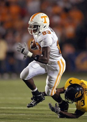 BERKELEY, CA - SEPTEMBER 01: Denarius Moore #83 of the Tennessee Volunteers carries the ball as he evades Brandon Hampton #3 of the California Golden Bears at Memorial Stadium on September 1, 2007 in Berkeley, California. (Photo by Jonathan Ferrey/Getty I