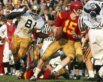 Notre Dame's Alan Page putting pressure on the USC QB